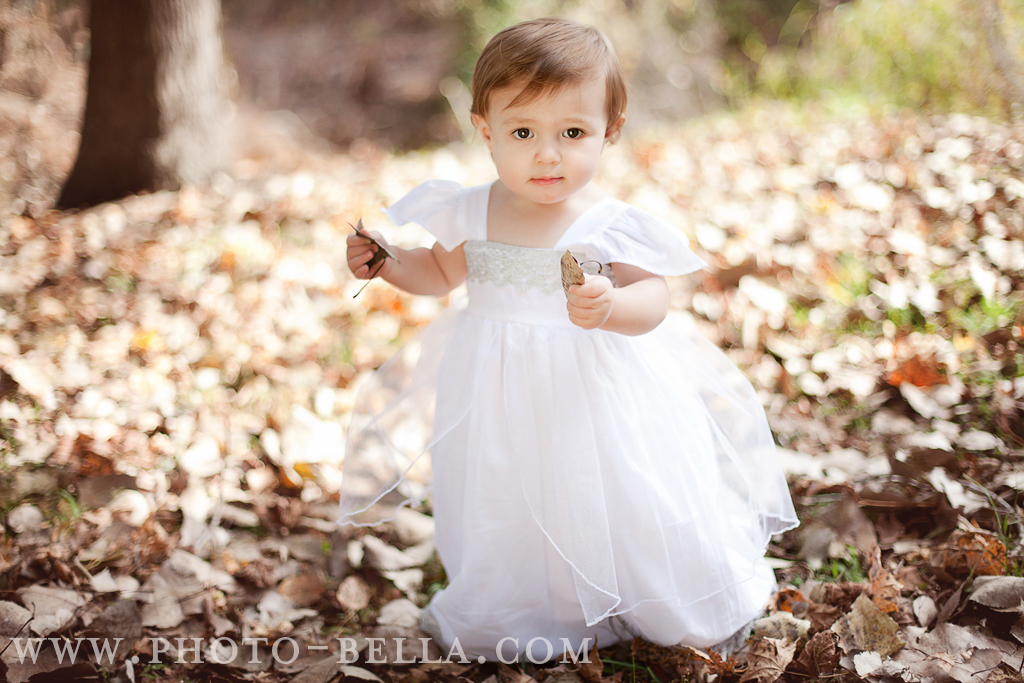 photo of one year old baby in white dress