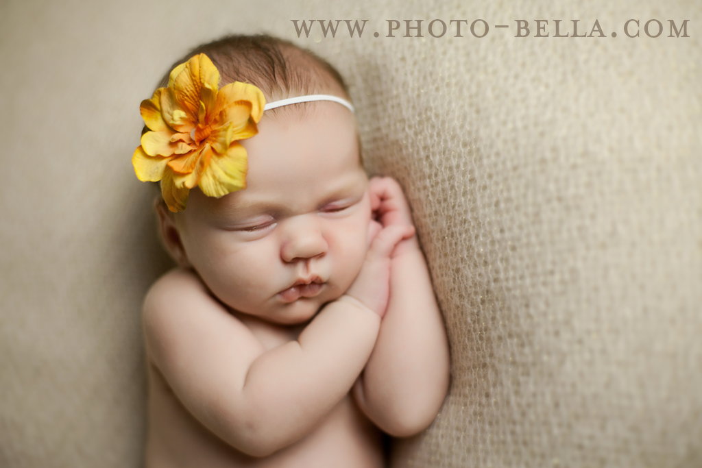 photograph of newborn baby on beige background